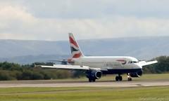 British Airways A319 G-EUPK landing at MAN/EGCC (AviationEagle32) Tags: man manchester flying airport aircraft airplanes apron landing planes airbus ba britishairways manchesterairport a319 planespotting egcc airbus319 cfm reversethrust a319100 geupk toflytoserve
