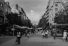 Sofia downtown (Georgi C) Tags: street city sky people blackandwhite bw film church clouds downtown cityscape sofia walk streetphotography bulgaria ilford ilfordfp4 filmphotography citycenters vitoshka sofiacity carlzeissjenatessar50mmf28 sofear