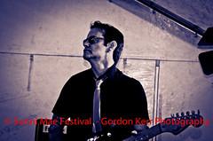 In the Spotlight (pickup2sticks 7.77 million views) Tags: light portrait musician music monochrome glasses nikon shadows guitar band tie guitarist gjkerr