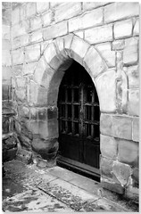Gated (DeeGee1966) Tags: door old blackandwhite bw monochrome stone powershot doorway gated entry barred canona480