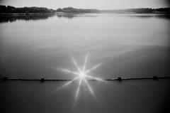 Underwater Star (PdD Photography) Tags: sky sun water 35mm canon star coast blackwhite lakes northumberland 35mmfilm filters bnw kodakfilm northumberlandcoast star8 stareight
