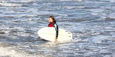 Out of the Surf (mootzie) Tags: red sea white black beach girl out leaving surfer aberdeen surfboard vest leash wetsuit