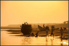 Water Play (ujjal dey) Tags: sunset silhoutte waterplay digha ujjal subarnarekhariver ujjaldey