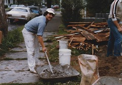 PETE WORKING CONCRETE IN 1985 (richie 59) Tags: ulstercountyny ulstercounty newyorkstate newyork unitedstates kingstonny kingston midtownkingstonny midtownkingston midtown chryslercorporation spring richie59 america outside people constructionarea constructionsite man construction oldphotograph olddays oldphoto 1985 photoscan june1985 june81985 35mmfilm 35mm filmcamera filmphotography film person 1980s americancity uscity masonry masons house oldhouse oldwoodenhouse woodenhouse frontyard yard sidewalk trees cement working work workers city smallcity urban citystreet street hudsonvalley midhudsonvalley midhudson nystate nys ny usa us parkedcars cars