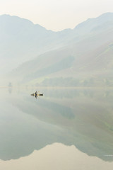 Canoeist on Buttermere (Jonny_Royale) Tags: canoeist buttermere lake district cumbria england uk boat reflections mountains fisherman sunrise foggy mist yellow black landscape minimalistic wild camping early morning breakfast canon water fishing canoe