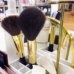 cosmetic brushes at a beauty counter (ourworldisbeauty) Tags: cosmetics makeup kabukibrush makeupbrush foundation brush liquid contour