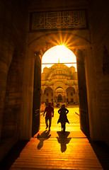 Another Country, Another Portal (Stuck in Customs) Tags: istanbul stuckincustomscom treyratcliff turkey treyratcliffcom trey ratcliff stuckincustoms temple horizontal colour color day time daily photo rr outdoor outdoors outside hdr photography aurora 2017 macphun mosque black brown gold sky clouds building worship religion people october 2016 p2016 architecture sun orange yellow glow door doorway