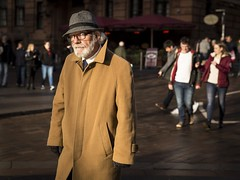 Secret Agent Man (Leanne Boulton) Tags: urban street candid portrait portraiture streetphotography candidstreetphotography candidportrait streetlife old elderly aged man male face facial expression look emotion feeling beard hat camel coat hue winter sunlight tone texture detail depthoffield natural outdoor light shade shadow naturallight city scene human life living humanity people society culture canon 5d canoneos5dmkiii 70mm colour color ef2470mmf28liiusm character glasgow scotland uk