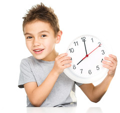 Boy is holding big clock (mommymundoxyz) Tags: holding morning schedule early confident serious cheerful smiling time disturb caucasian brunette male boy child kid people one person horizontal isolated clock get up eight awake alert closeup portrait smile happy cutout beautiful childhood concept cute education expression human little last minute small young alarm wake