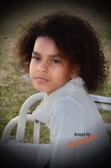 The neice_5391 (2HandzUp1913) Tags: autumn bench outside kid backyard nikon child curls swing niece biracial vignette naturallycurlyhair cowlneckdress 2handzup1913 naturallywavyhair thelandofozkidphotographer