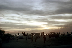 24-364 (ndpa / s. lundeen, archivist) Tags: ocean light sunset sea sky people bali color cars film beach water silhouette clouds 35mm dark indonesia evening shadows jeep jeeps dusk nick silhouettes bikes bicycles vehicles southpacific 24 1970s 1972 indonesian parkedcars balinese dewolf oceania pacificislands nickdewolf photographbynickdewolf reel24