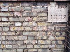 Old Wall 009 (saxonfenken) Tags: 6900misc 6900 pregamesweepwinner bricks wallnumbers old vintage misc patten herowinner gamewinner storybook right perpetual tcf