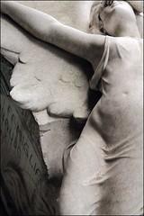 Angelo della tomba Ribaudo (Aramisse) Tags: italy sculpture cemetery angel death europe italia mort ange sensual genoa genova joydivision angelo sensuality italie sensuel cimitero cimetire gnes lovewilltearusapart sensualit cimiteromonumentaledistaglieno aramisse
