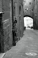 a street in siena (Roving-Aye!) Tags: street italy holiday blackwhite tuscany siena 2014 cobbledstreet windingstreet canon7d
