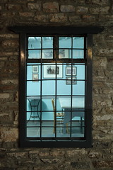 Window into the past (Elios.k) Tags: camera old travel blue light summer vacation color colour travelling window coffee vertical shop stone wall night canon dark table outdoors photography bay wooden bars village place chairs interior empty room traditional picture august nopeople greece frame hanging pelion barred kafenio magnisia kafeneio pagasitic lafkos 5dmkii