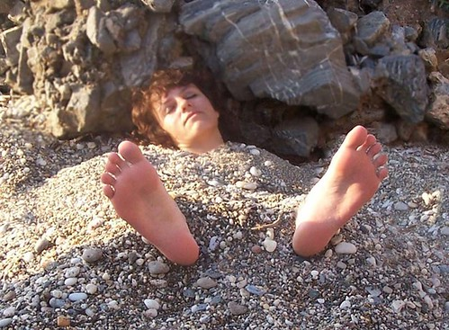 Ticklish bare feet soles tickled more