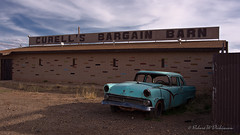 Busted-Up Ford in Front of Curell's Bargain Barn on Route 66 in Winslow, Arizona (eoscatchlight) Tags: arizona ford abandoned route66 roadsideamerica rustyandcrusty winslow fordfairlane curellsbargainbarn