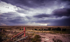 Storms of the Panhandle (Chains of Pace) Tags: road storm oklahoma clouds rural landscape perspective prairie panhandle oldwest guymon