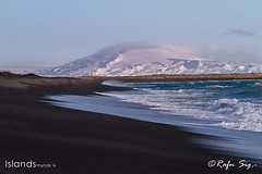 Black beach with Volcano in the background