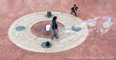 Chasing (PA183572) (Michael.Lee.Pics.NYC) Tags: park boy newyork fountain smile soap terrace central bubble chase bethesda