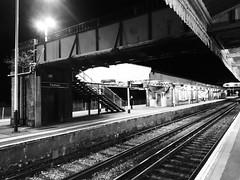 Waiting (Mr Exploding) Tags: monochrome station train footbridge platform hampshire railwaystation vignette fareham vignetteforandroid