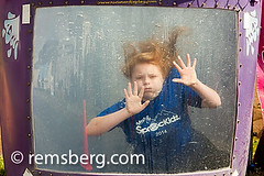 Girl being dunked into a bin of water at an event in Alaska (Remsberg Photos) Tags: summer portrait usa motion game water girl childhood alaska youth fun trapped funny eyecontact comedy humorous underwater escape child faces stuck action palmer event entertainment summertime through concept activity excitement playful bizarre struggle digitalimage pressing coldtemperature