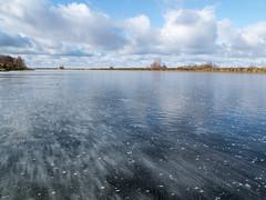 A frozen bayou (andrey.senov) Tags: russia kostroma province volga river water anabranch autumn fall bank clouds sky ice              fujifilm fuji x10 fujifilmx10 35faves