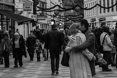 Embrace (Vibeke Sonntag) Tags: christmas street winter bw love canon copenhagen 50mm candid streetphotography streetlife embrace strget