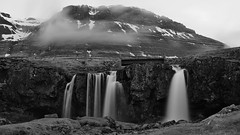 Iceland harsh and smooth (lunaryuna) Tags: iceland westiceland snaefellsnespeninsula kikjufellsfoss waterfall mountain bridge textures rockface lowclouds evening wilderness blackwhite bw monochrome lunaryuna