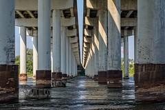 Under the Road Again (brev99) Tags: sigma70mm28macro bridge d7100 perfecteffects10 ononesoftware columns water arkansasriver shadows rust support roads