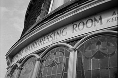 Cutting Corners (bigalid) Tags: film 35mm revue 35fc haking ilford xp2 fixedfocus c41 bw carlisle september 2016 barbers sign