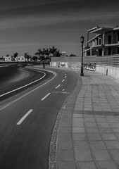 Urban Corralejo ( Jamie Mitchell) Tags: corralejo fuerteventura urban landscape town city road path cycle route pavement sidewalk abandoned industrial sky monochrome black white canary islands spain