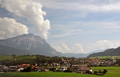 Austrian valley floor (Vee living life to the full) Tags: italy leger travel touring holiday nikond300 heathaze view road sky cloud blue water light evening sunset sunrays sunburst lowlight highlight people travelling sleeping sun castle town village cloudformationsriver