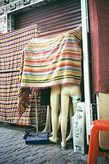 (Alexander Graeff) Tags: marroco leica mini 2 analoug analog film 35mm noise beach strand marocco people outdoor marakesch marakesh market hidden hindi ass figures sculpture puppets puppy blanket