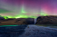 Aurora polaris above skogafoss waterfall, iceland (Daniel Vie fotografia) Tags: action arctic astronomy astrophotography aurora autumn beauty borealis bright celestial climate color colored dancing dark discharge glow glowing green hemisphere iceland image ionosphere lake landscape lights luminosity magnetic moonlight natural nature night north northern outdoors particle phenomenon polar polaris reflection skogafoss sky solar space star vibrant water wind winter