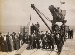 Visit of the Channel Fleet to Sunderland, 1895 (Tyne & Wear Archives & Museums) Tags: portofsunderland sunderland riverwear channelfleet crane victorian hats ceremony pier harbour marine wearside historic blur mark industrialheritage blackandwhitephotograph digitalimage northeastofengland unitedkingdom memorialstone laying southpier commemoration event occasion visit 12september1895 shipbuildingheritage maritimeheritage archives abstract bank water sky chain flag pole windy hat cane trousers crease fabric ribbon scarf shirt moustache beard dress blouse cog wheel timber mechanical blocks cabin window glass rail soil debris interesting unusual fascinating