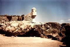 Portugal (6) (The Spirit of the World) Tags: sea seashore rocks shoreline atlanticocean lookout tower cascais portugal europe seawall 1986 film print analogphotography lookouttower