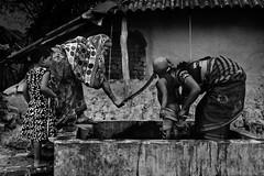 Lifestyle of a village (mailmesanu20111) Tags: mohter child relation canning village poverty dailytask hut india calcutta kolkata south24 pargana people black white blackandwhite nikon