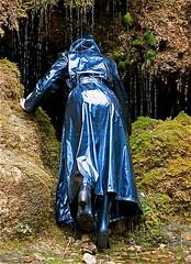 e0a4577f90298499ea127b3a46694c33 (npeter50) Tags: raincoat blue shiny