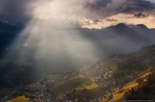 Italy. Dolomites. The slopes of the village of Santa Cristina Val Gardena in evening sunshine