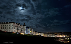 Moonlit Promenade (manxmaid2000) Tags: moon moonlit clouds sky spooky isleofman night porterin promenade evening skyscape iom hotels lunar dark winter autumn bluehour cloudscape moonlight blue apartments nightsky stars cloud hotel cloudy
