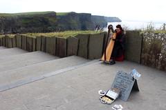 Celtic Harp Performer in The Cliffs of Moher (Douglas Pfeiffer Cardoso) Tags: ireland celtic harp atlanticocean thecliffsofmoher celticharp countyclare westireland republicofireland cliffsofmoherwalkingtrail