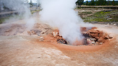 Red Sputterer (G0Da) Tags: hot water nationalpark colorful mud pots springs yellowstone wyoming thermal boiling