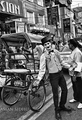 Clown act ! New Delhi. (Aman-Sidhu) Tags: new blackandwhite bw india blackwhite delhi streetphotography newdelhi indianstreets newdelhistreets marketinindia streetphotographyinnewdelhi