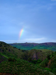 """Rainbow fragment above rocky hills zoom • <a style=""""font-size:0.8em;"""" href=""""http://www.flickr.com/photos/34843984@N07/15358486149/"""" target=""""_blank"""">View on Flickr</a>"""