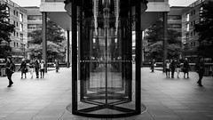 Parallel Doors - Explored (Sean Batten) Tags: street england people blackandwhite bw reflection london 35mm nikon df unitedkingdom streetphotography eastlondon revolvingdoors ref