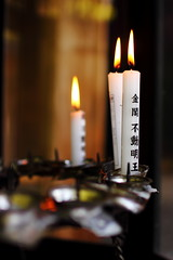 Prayer in Kinkakuju Temple, Kyoto (YG Low) Tags: travel japan canon temple asia sigma 30mm 60d