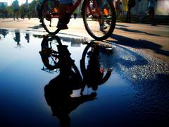 Biking in the sky (Cristian Ştefănescu) Tags: reflection water bike marathon spiegelung bucharest fahrrad fav25 bucurești apă bicicletă baltă oglindă
