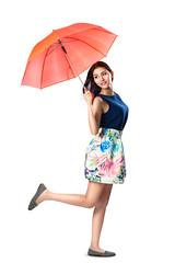 Young asian woman holding a umbrella in the wind (Patrick Foto ;)) Tags: autumn red portrait people woman white cute girl beautiful beauty face rain smiling fashion lady female standing umbrella hair studio season asian fun thailand happy person one model holding pretty looking adult background joy young posing style full business human thai attractive concept joyful length isolated