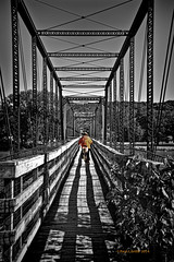 Three Lanes No Passing (jackalope22) Tags: bridge bw color point perspective symmetry vanishing rider linear selective